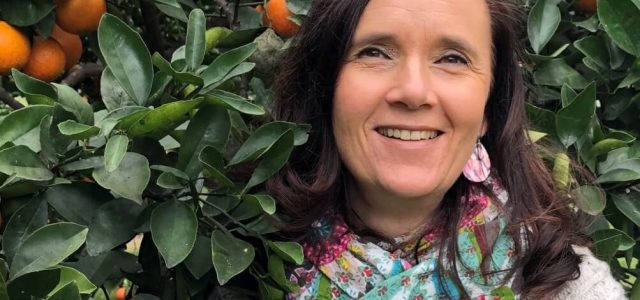 Beatrice Dean - German naturopath - next to orange tree, talks about Winter wellness